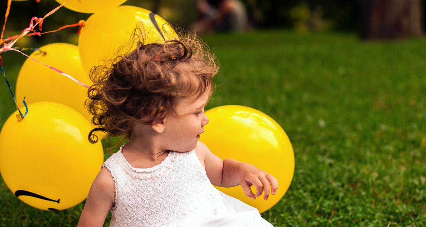 Baby mit Ballons